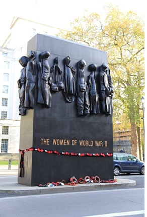 Figure 2: The Women's Memorial, showing the empty clothing and hand-crafted wreaths